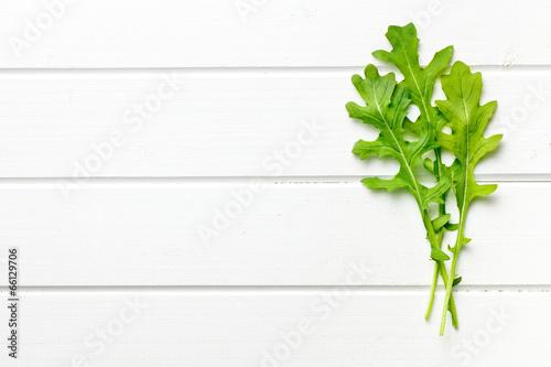 fresh arugula leaves on kitchen table Canvas Print