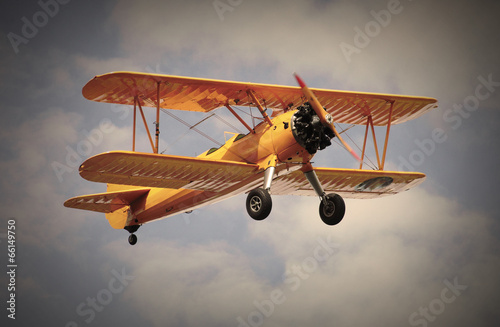 Retro style picture of the biplane. Wallpaper Mural