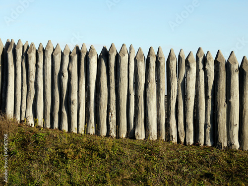 Fotografie, Obraz  wooden palisade of the protective fence