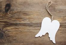 Wings Of Angel On Wooden Backg...