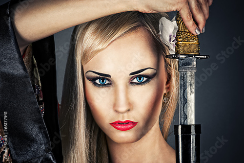 beautiful woman portrait with a samurai sword