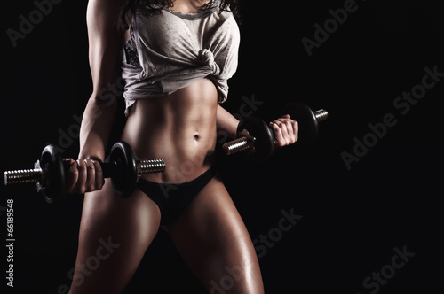 Fitness woman in hard training