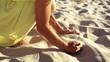Girl picking up sand