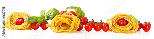 Fotografiet  Raw homemade pasta and tomatoes, isolated on white