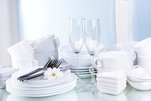 Set Of White Dishes On Table O...