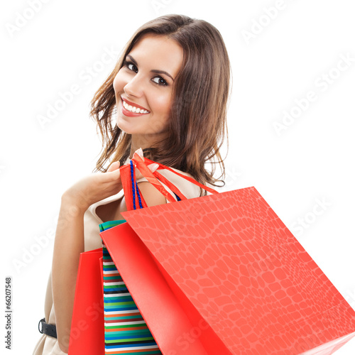 Fotografía  Young happy woman with shopping bags, isolated