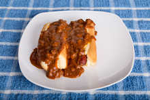 Two Hot Dogs Smothered In Chili