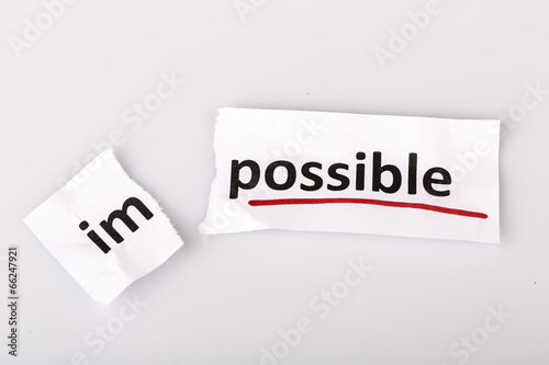 Fotografia  The word impossible changed to possible on torn paper