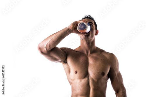 Fotografie, Obraz  Muscular male bodybuilder drinking protein shake from blender
