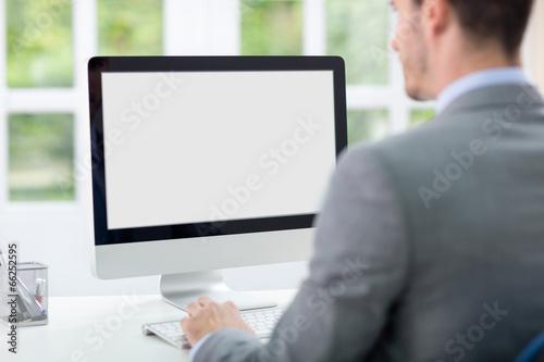 Fotografia  Businessman in front of computer