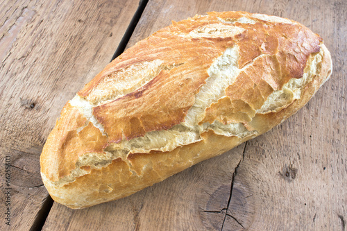Homemade bread on wooden background - 66255503