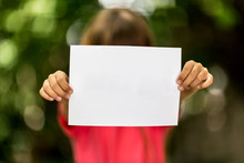Girl With Blank Piece Of Paper
