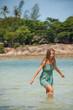 woman standing knee-deep in water