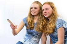 Two Girls Watching TV