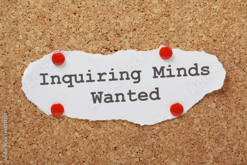 Fotografering  The phrase Inquiring Minds Wanted on a notice board