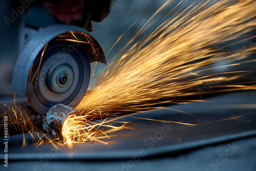 Worker cutting metal with grinder Tableau sur Toile