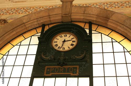 Portugal. Porto. Old clock on  wall station Sao Bento.