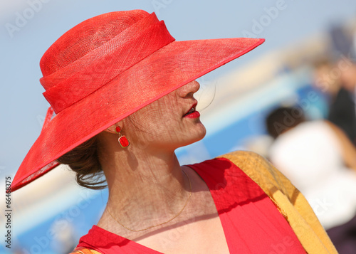 Tablou Canvas Elegant woman with her beautiful hat