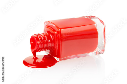 Photographie  Red nail polish spilled on white background, clipping path