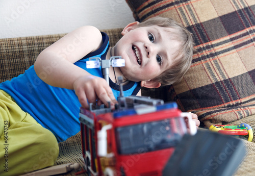 Poster South America Country happy cute boy playing with toys and laughing