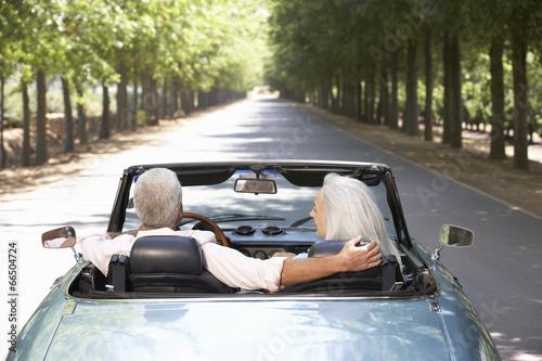 Senior couple in sports car - 66504724