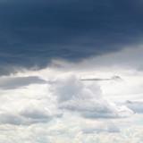dark grey rainy clouds in overcast sky