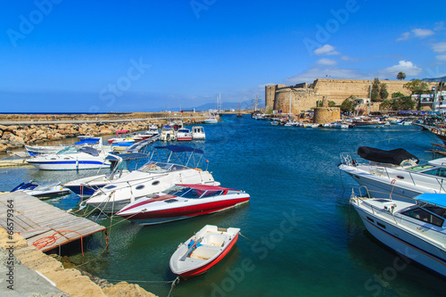 Boats in a port of Kyrenia (Girne), castle in the back, Cyprus