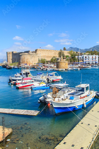 City on the water Boats in a port of Kyrenia (Girne) a castle in the back, Cyprus
