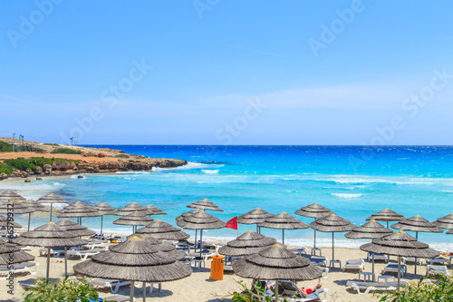 Photo Stands Cyprus A view of a azzure water and Nissi beach in Aiya Napa, Cyprus