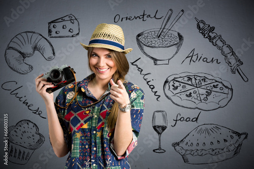 Fotografia  food photographer - Nice female tourist with draw different type