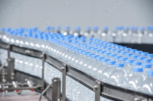 Valokuva  Plastic bottles on conveyor belt