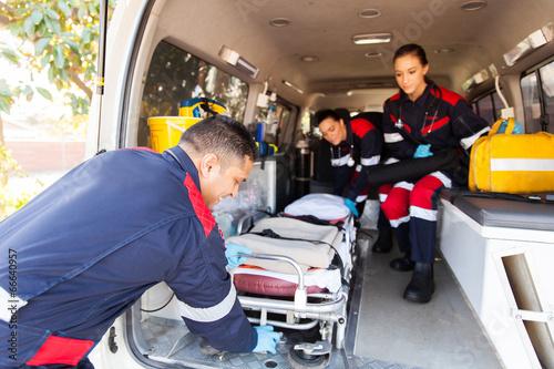 paramedics taking stretcher out of an ambulance Wallpaper Mural
