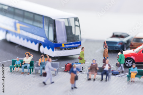 Fotografie, Obraz  Miniature travellers at a busy bus station
