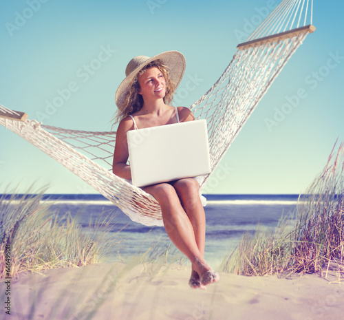 Beautiful Woman Sitting on a Hammock by the Beach #66649508