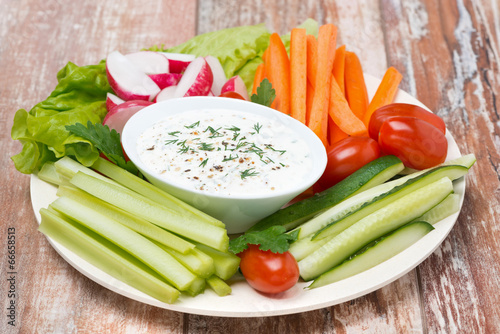 plate with fresh vegetables and yoghurt sauce