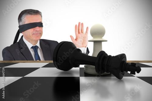 Fotografie, Obraz  Composite image of mature businessman in a blindfold