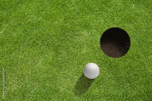 Spoed Foto op Canvas Golf Golf ball near the hole
