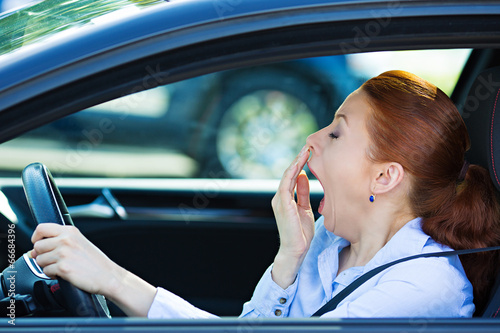 Sleepy fatigued driver, driving car, isolated city traffic Wallpaper Mural