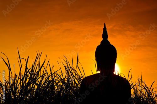 Poster Temple Big buddha statue at Wat Muang with sunset sky in Thailand