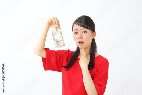 Fotografie, Obraz  一万円を持って悩む人