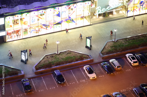 People walk on New Arbat Street at night