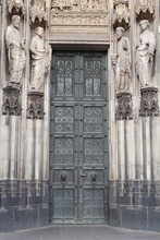 Catholic Saint Figures At Side Entrance Of Cologne Cathedral
