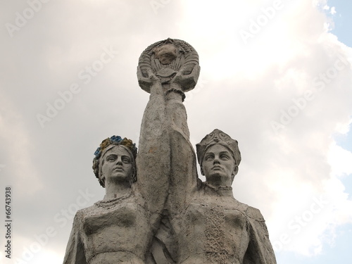 Soviet monument. Russian and Ukrainian girls hold hands
