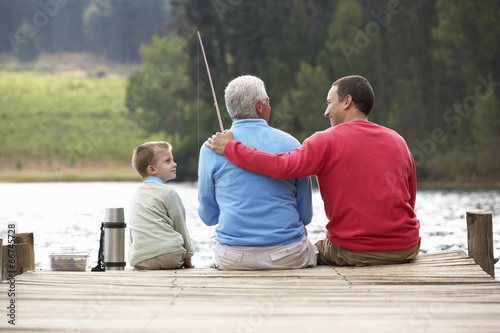 Fotobehang Vissen Father,son and grandfather fishing
