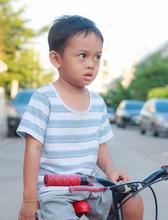 Asian Kid On Bike