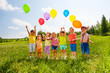 canvas print picture Seven children with balloons in green field