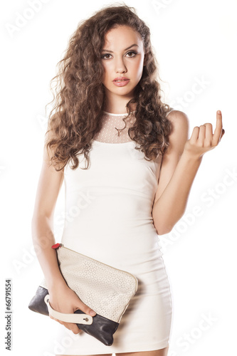 Photo  pretty girl in a short white dress calls with her index finger