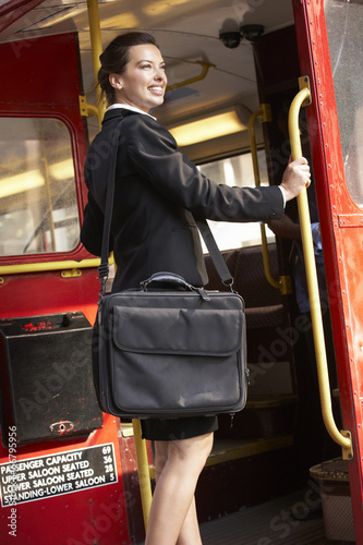 Photo  Businesswoman standing on Routemaster bus platform