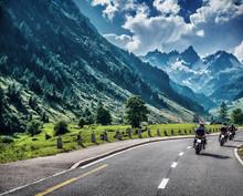 Motorcyclists On Mountainous Road