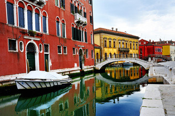 FototapetaVenice, Burano island, boats on canal and colorful houses, Italy